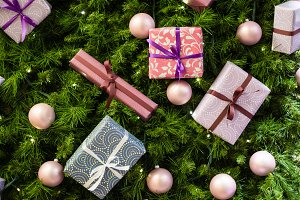 Photo of Christmas fir-tree background with balls, purple boxes