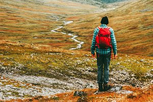 Man hiking trek in mountains