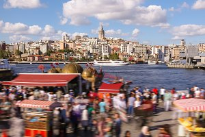 people walking around famoust tourist place in Istanbul with Galata Tower view and Bosphorus