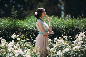 beautiful girl dreams in the garden