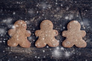 Christmas gingerbread men cookies on wooden background