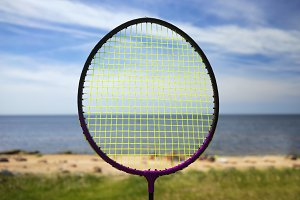 Racket on the background of the sea