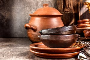 Clay rustic kitchenware - pot, bowls and plates from Chilean Pomaire