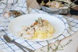 Chicken fillet in a creamy sauce with mashed potatoes and capers, thyme