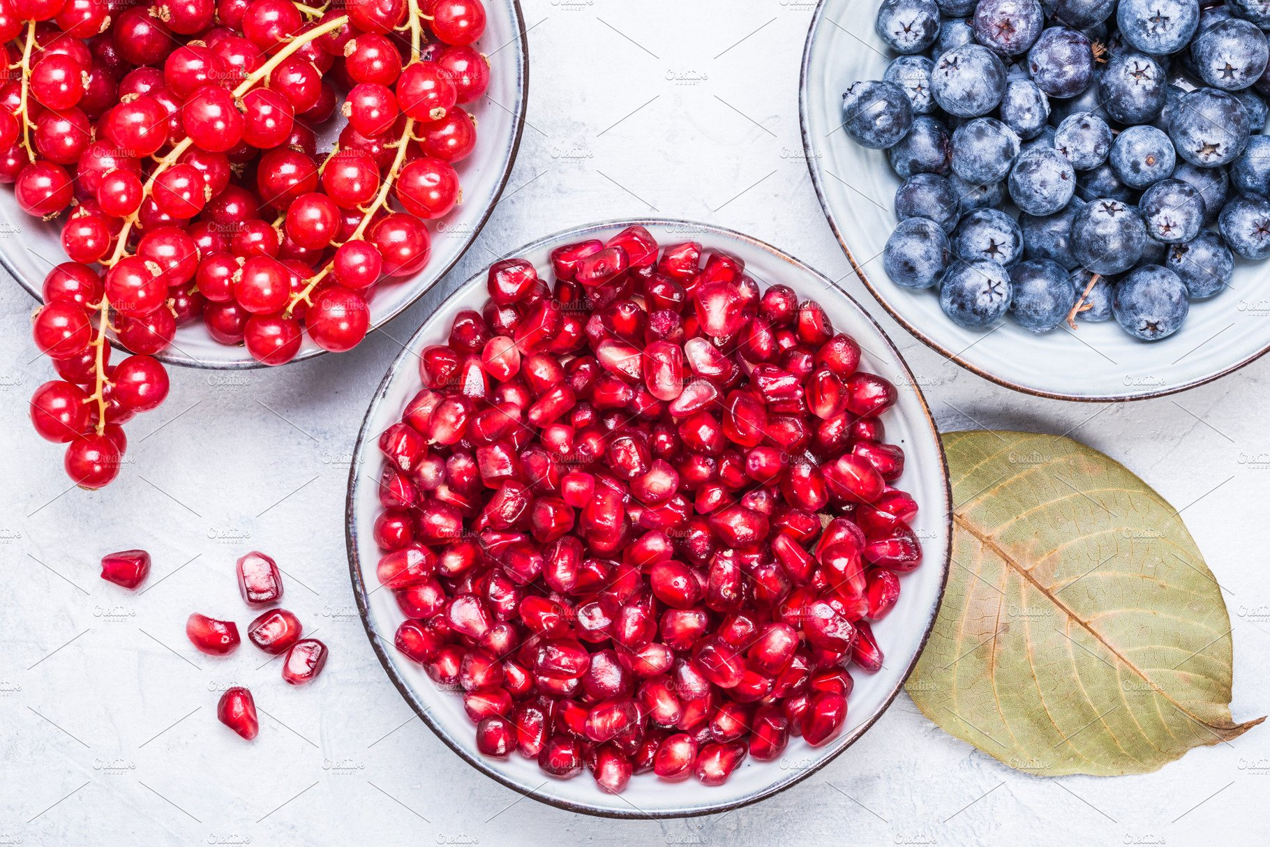 Berries and pomegranate. | High-Quality Food Images ~ Creative Market