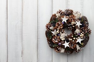 Christmas wreath on white wooden pla