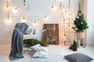 Winter home decor. Christmas tree in loft interior against brick wall. Ol