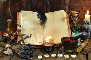 Old witch book with magic objects