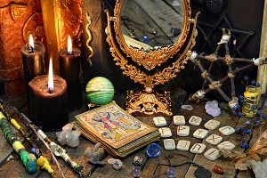 Black candles and tarot cards