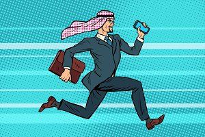 Arab businessman runs forward, phone and briefcase in hand