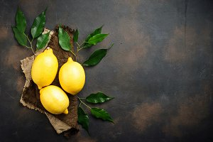 Fresh juicy lemons on rusty background