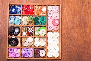 Colorful buttons in box