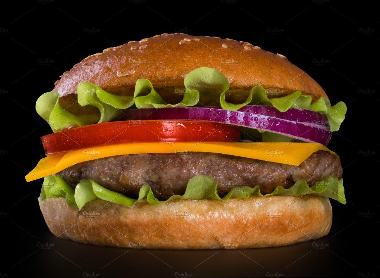 Burger on black background food images creative market for Ottos burger hamburg