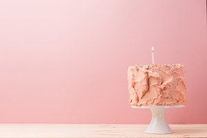 Delicious cake with lonely candle
