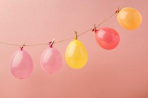 Shiny balloons arranged on rope