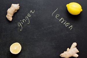 Ginger and lemon as prevention of colds. Dark background. Labels. Copyspace.