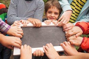 Hands holding advert board
