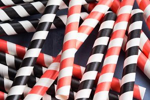 Red and black striped straws background