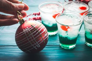 Christmas holiday green drinks and red bauble
