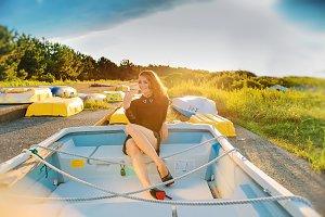 Beautiful woman sitting on the boat