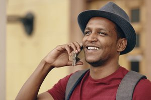 African american tourist man chatting with smartphone while travelling in Europe