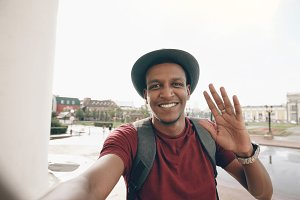 African american tourist man having online video chat using his smartphone camera while travelling in Europe
