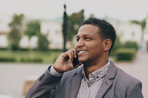 Close-up of Mixed race businessman calling mobile phone outdoors