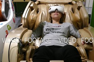 Massage chair and girl in goggles