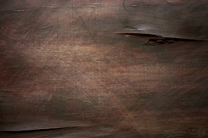 Brown scratched wooden board. Wood texture