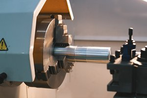 Rotated mechanism - automatic for machine processing of metal, industrial background