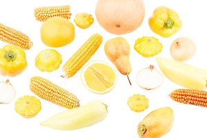 Background from yellow and orange fresh raw vegetables and fruits, isolated