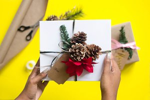 Black Woman Holding Holiday Gift