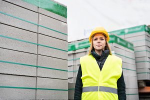 Woman worker standing in an industrial area.