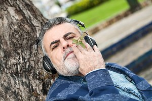 Man with beard listening to music