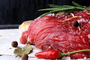 raw beef with rosemary and spices