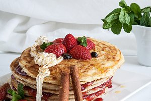 White plate full of pancakes
