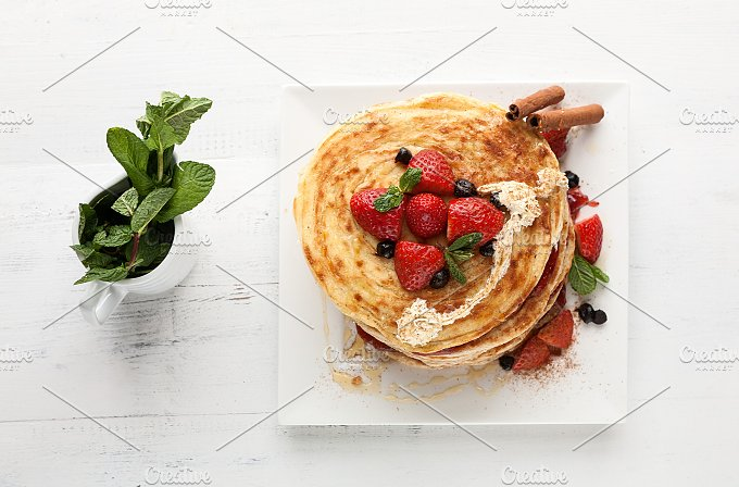 White plate full of pancakes - Food & Drink