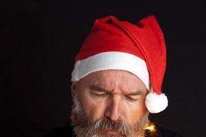 Mature man with santa hat.