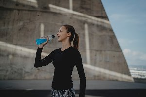 Fitness woman drinking before run