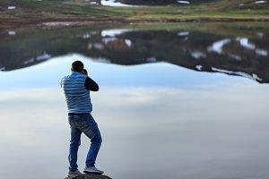 Landscape photographer photographing
