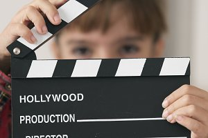 10-year-old girl with a clapboard