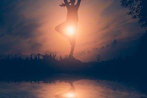 Woman yoga in sunset