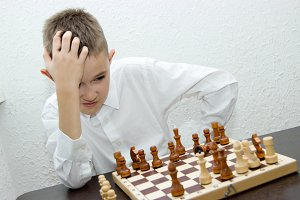 Smart teen boy playing chess. The game's concept, strategy and learning.