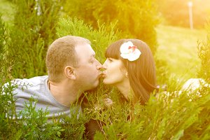 Closeup of couple in love kissing. Summer in the sun