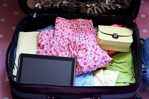 Baggage. Holiday, travel, journey. Trip and adventure.Packing summer clothes in a suitcase.