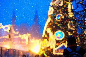 Christmas tree decoration on snowing square
