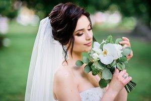 Brunette bride poses
