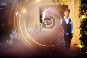 Light whirls around stunning bride