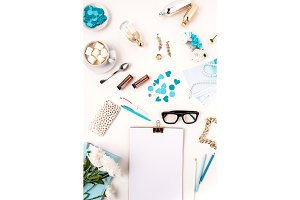 Still life of fashion woman,  blue objects on white