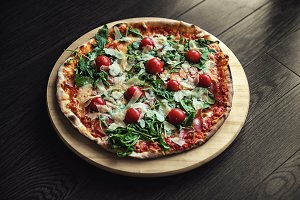 Delicious pizza on wooden background closeup photo